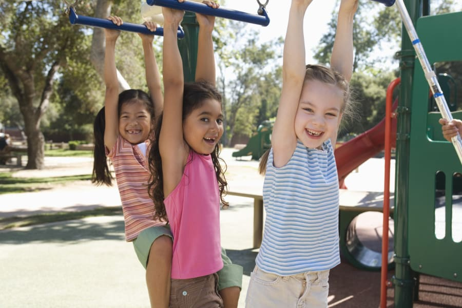 three girls playground day care center