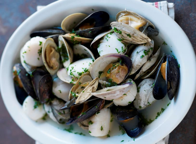 mussels scallops and clams in broth