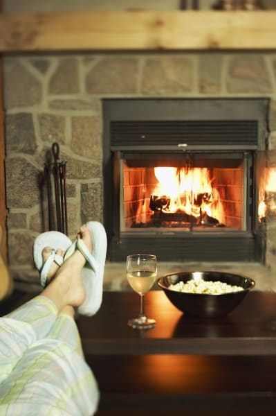 wine in front of fireplace