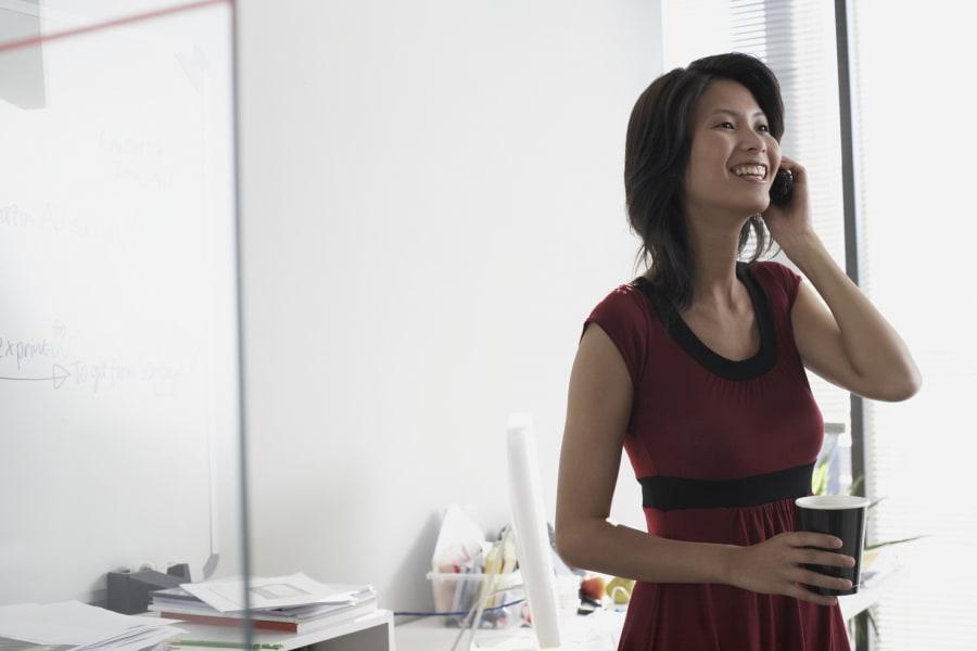 woman talking phone office