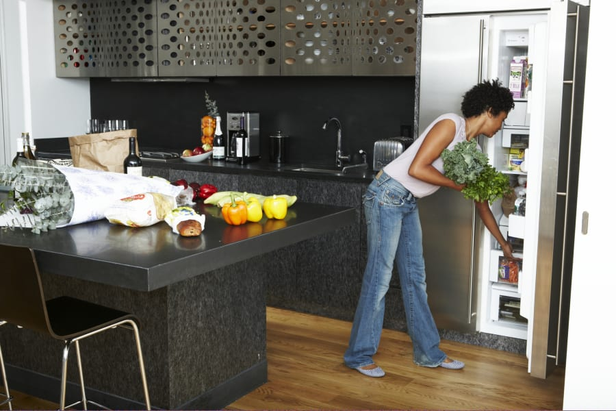 woman organizing fridge