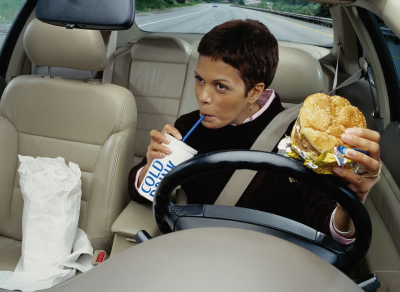 eating fast food car driving
