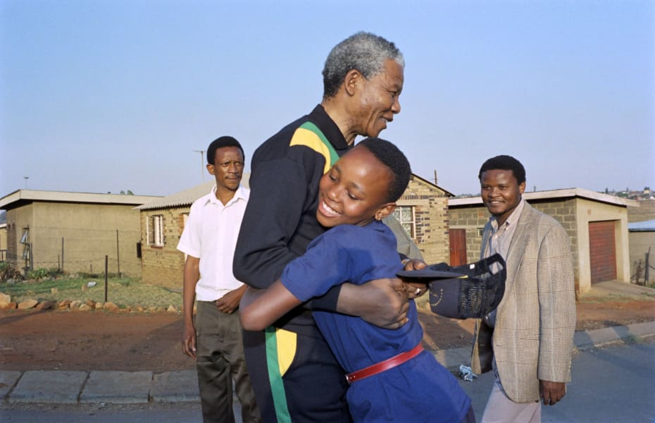 Mandela hug child 1990