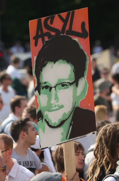 snowden face sign protest