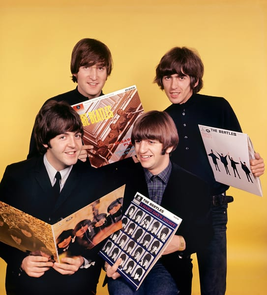 beatles holding albums