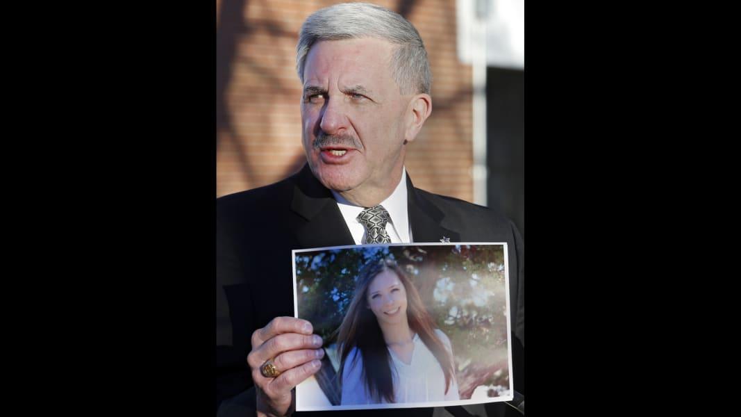 arapahoe sheriff holds victim photo