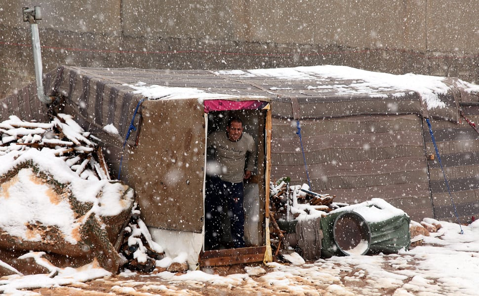 10 syrian refugees snow - restricted