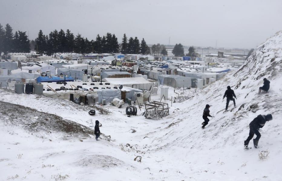 13 syrian refugees snow