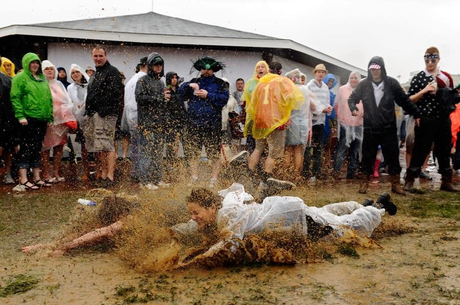kentucky derby fans in mud