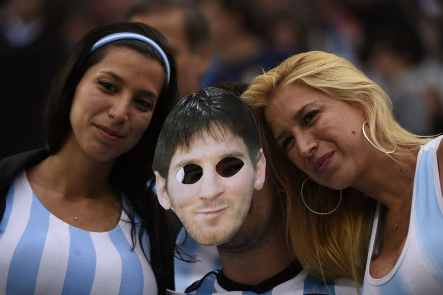 getty wc messi mask argentina fans
