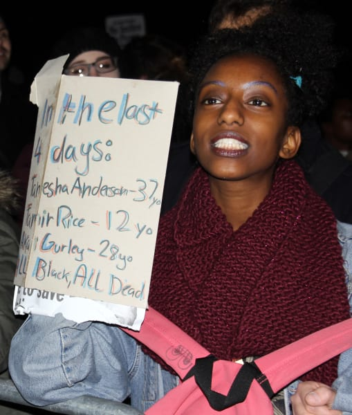 Protester with sign London to Ferguson