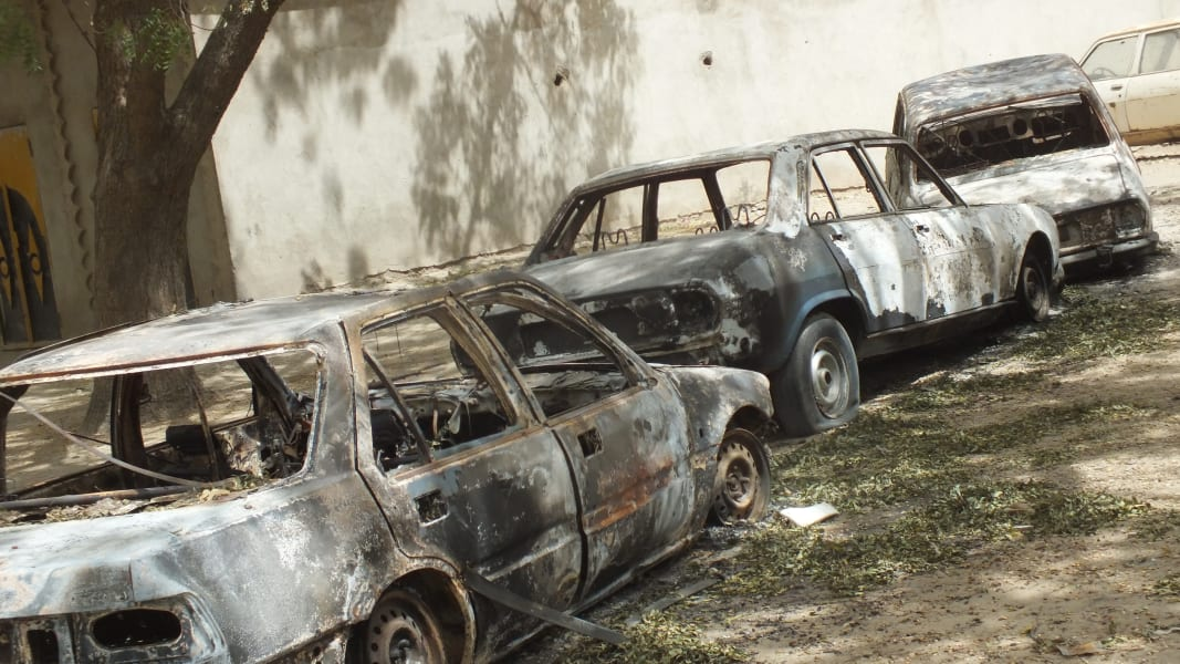 02_SHATTERED CARS OF Fotokol residents