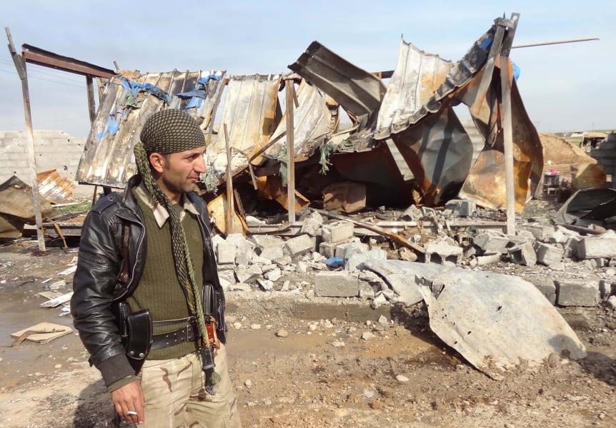 Peshmerga ruined house