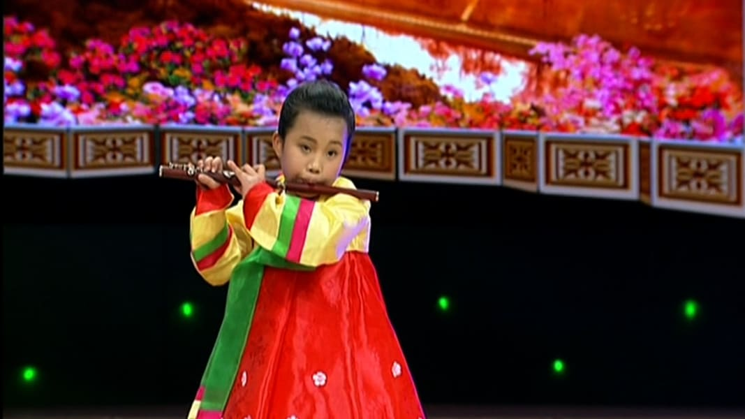 02 north korea girl playing flute