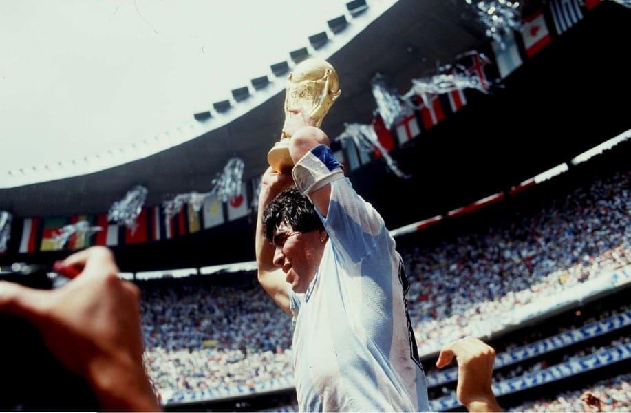 maradona holds aloft World Cup