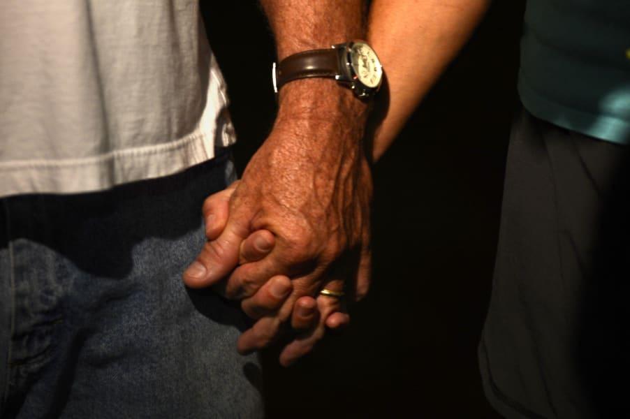 zachary hammond vigil holding hands