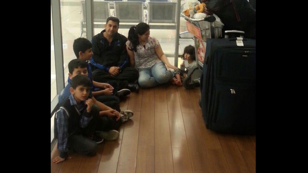 Kurdish family in airport