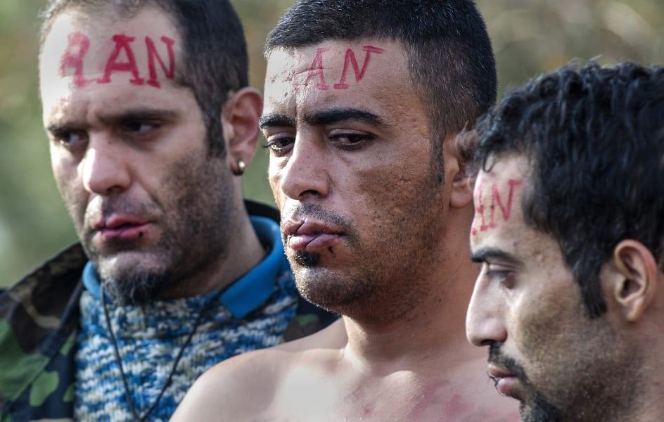 refugees iran lips sewn up