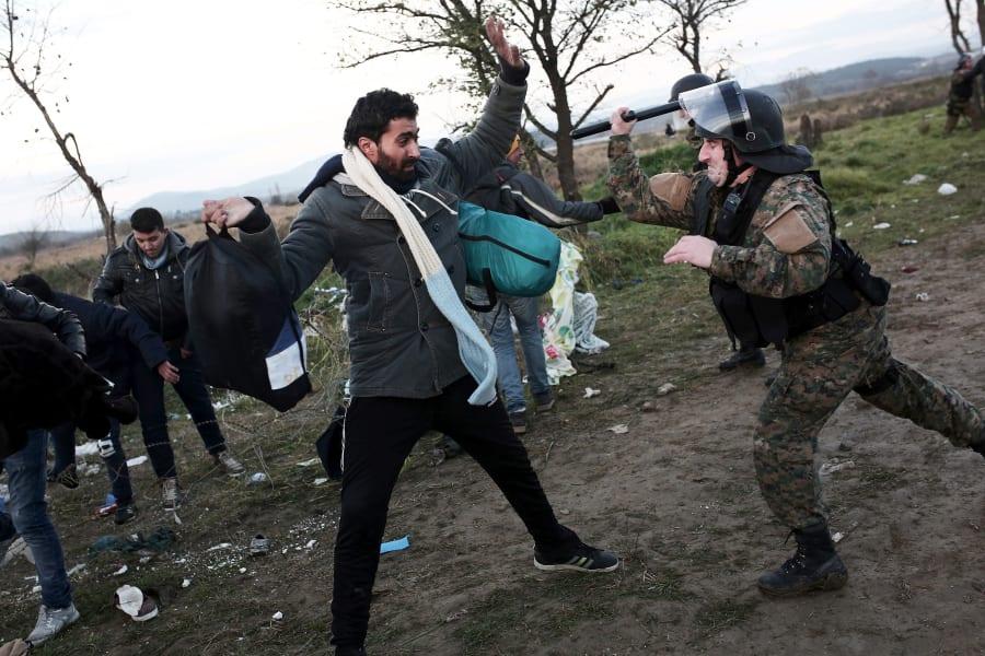 macedonia refugee police baton
