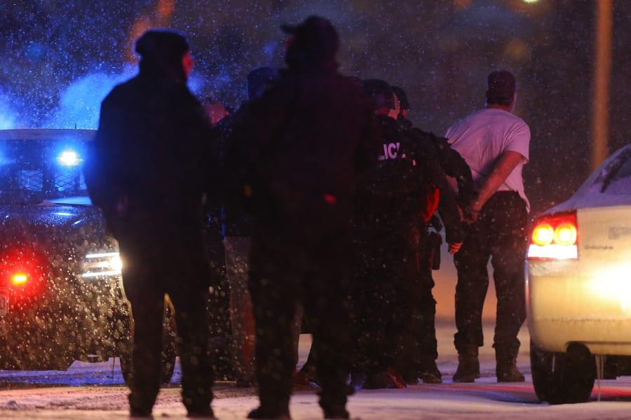 23 colorado springs shooting - suspect cuffs
