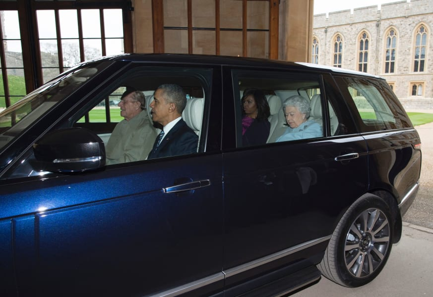 Obamas driving with the royals