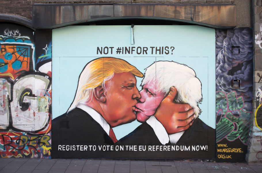 kissing mural trump johnson