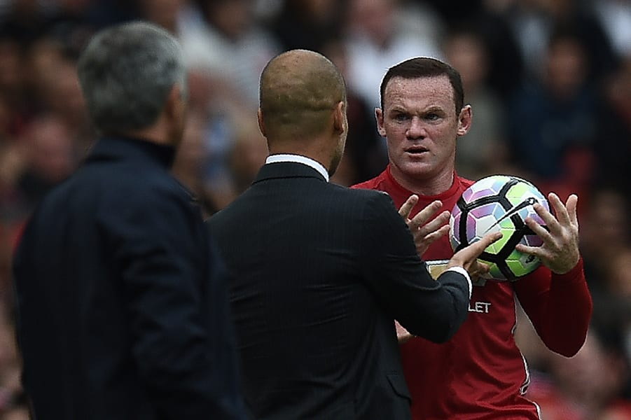 Wayne Rooney and Manchester City's Spanish manager Pep Guardiola clash