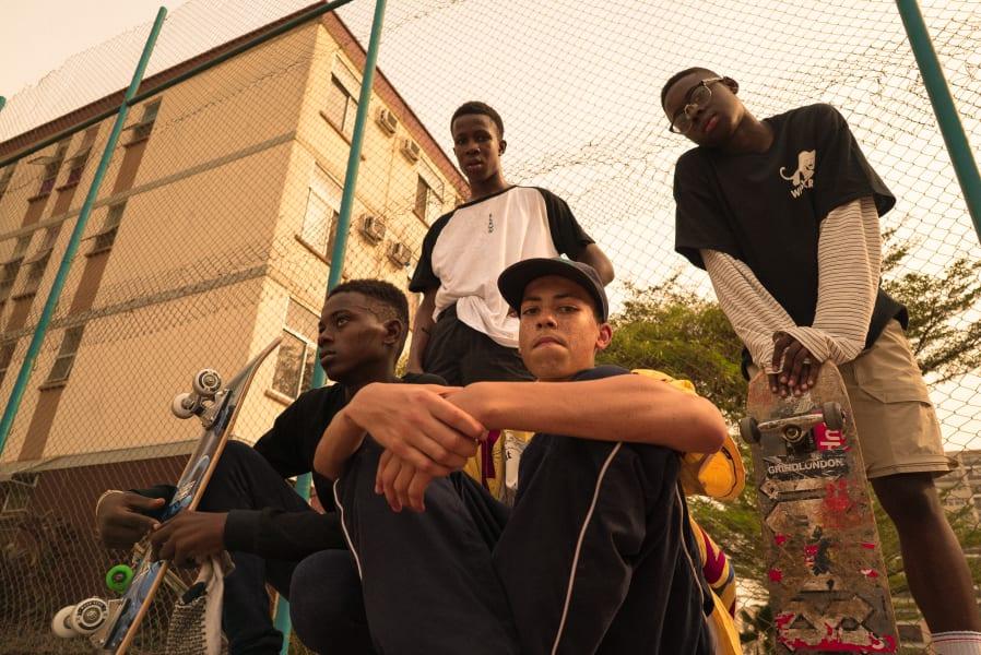 four guys skateboading Lagos