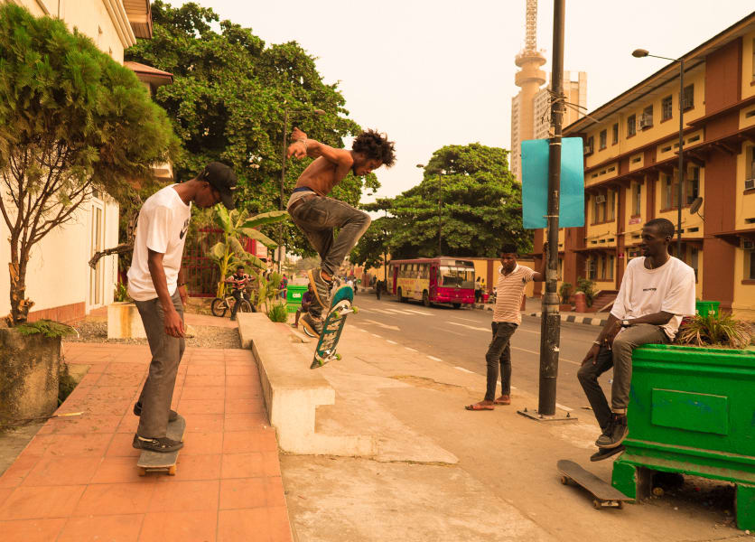 three boys skateboarding Lagos