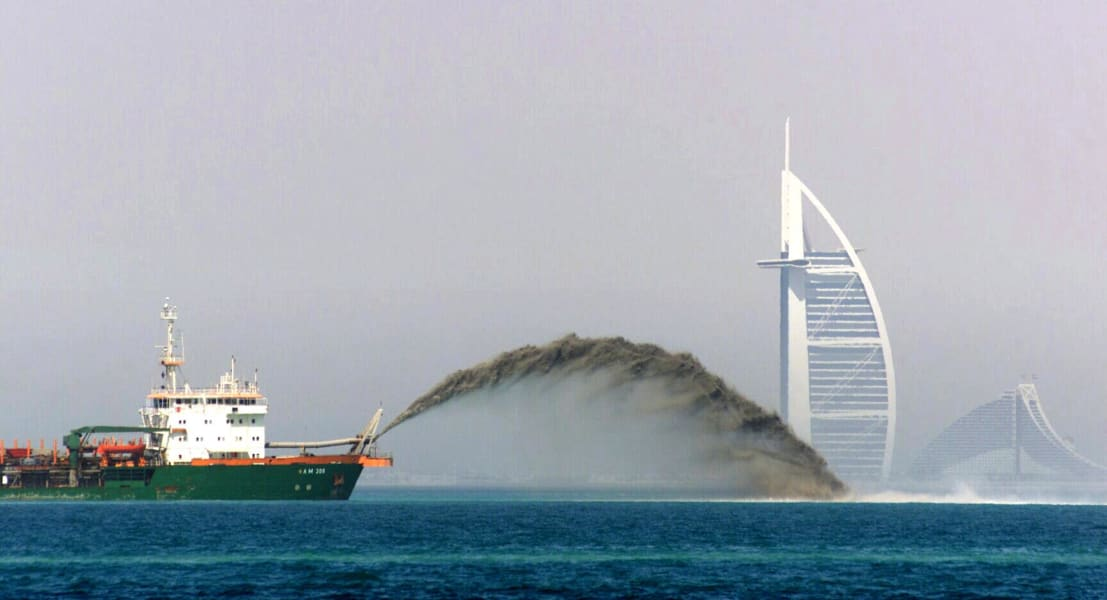 barge pumps sand onto sea bed dubai