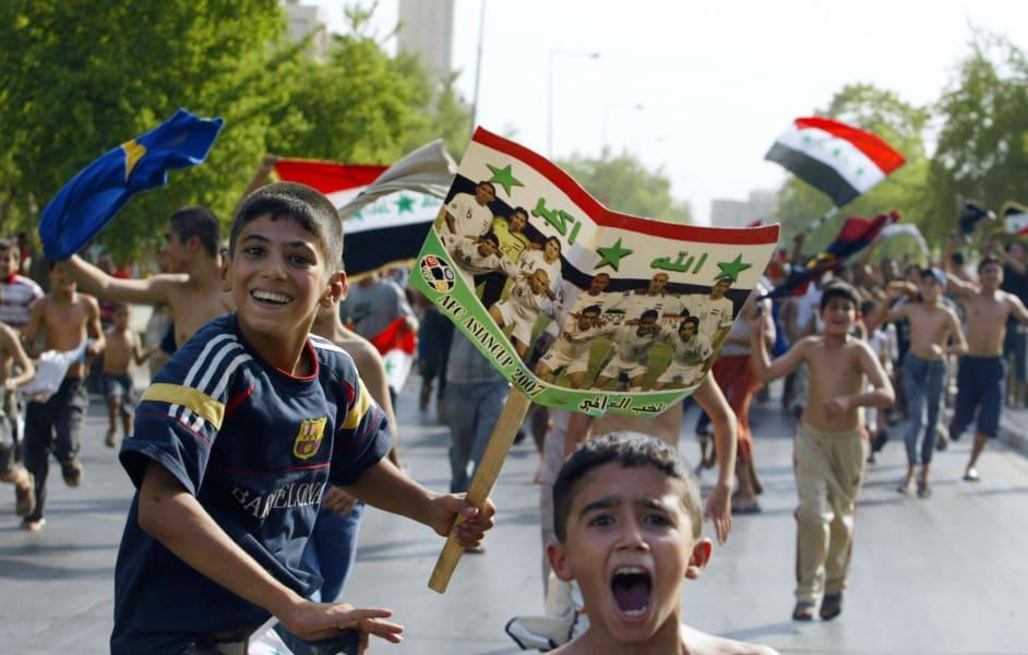 Iraq children football celebrate