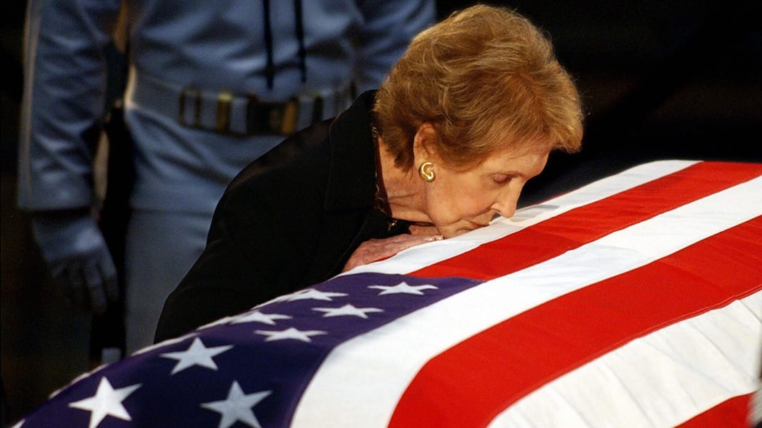 Nancy Reagan kissing Ronalds casket June 2004
