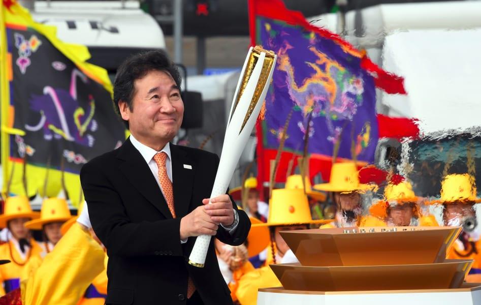 South Korean Prime Minister Lee Nak-Yon lights the Olympic torch incheon bridge pyeongchang winter games