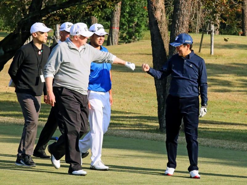 Trump Abe golf fist bump RESTRICTED