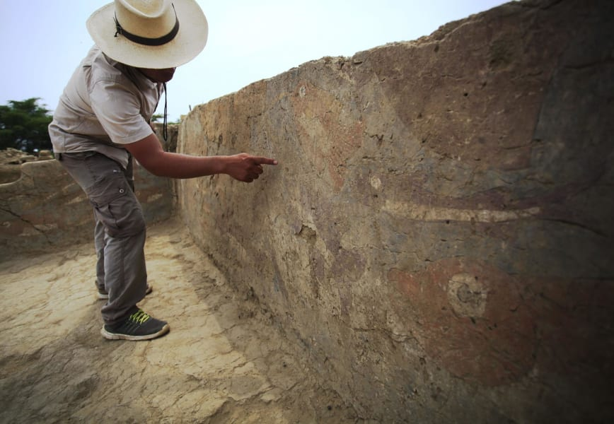 Moche mural archaeologist pointing