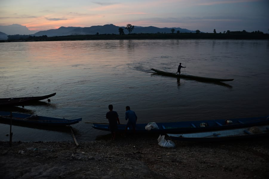 mekong river and fisherman in thailand