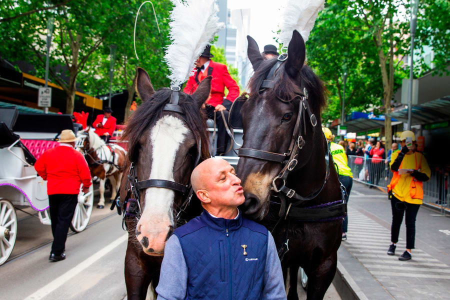 Former Melbourne Cup winning jockey Jimmy Cassidy kisses horse