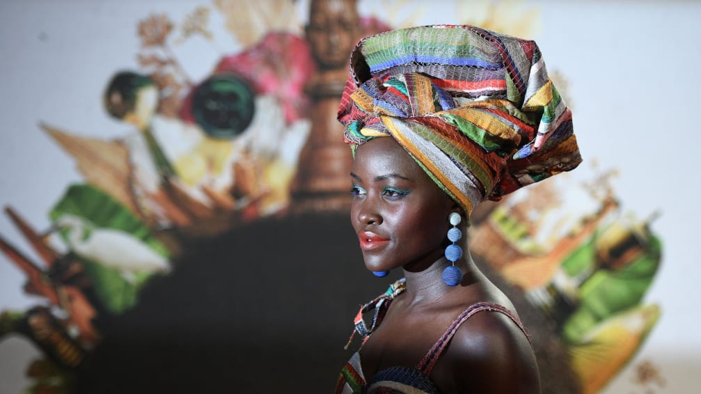 """Kenyan actress Lupita Nyong'o poses on the red carpet after arriving to attend a gala screening of the film """"Queen of Katwe"""" during the BFI London Film Festival in London on October 9, 2016. / AFP / Justin TALLIS        (Photo credit should read JUSTIN TALLIS/AFP via Getty Images)"""