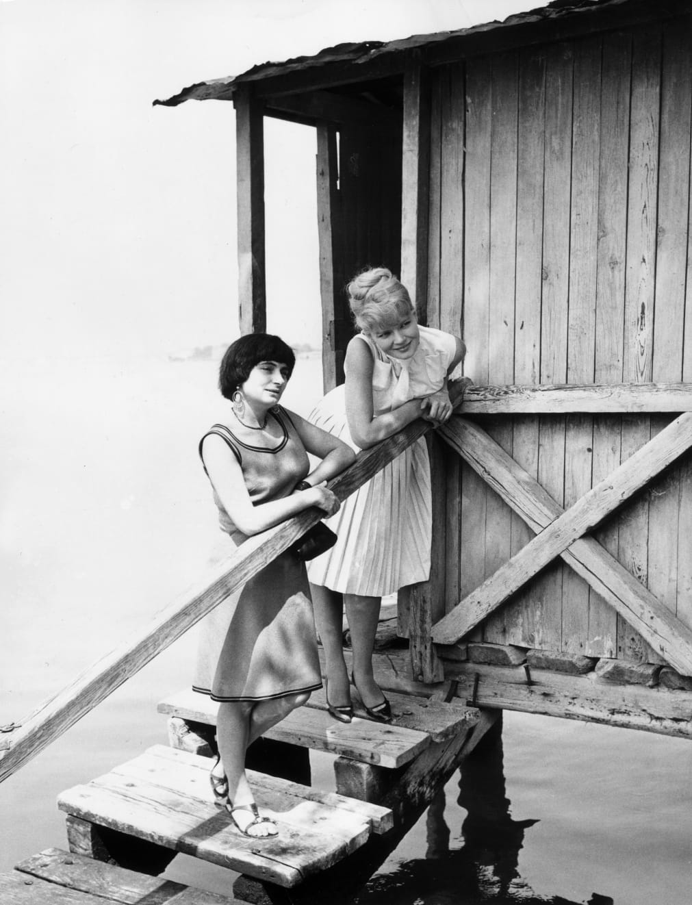Agnes Varda (left) at the Venice Film Festival in 1962 with Corinne Marchand, star of