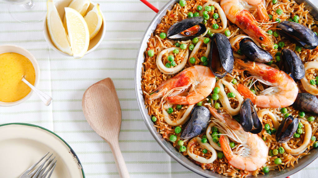14 spanish dishes you should try from churros to jamon cnn travel essential spanish dish fideua brindisa forumfinder Choice Image