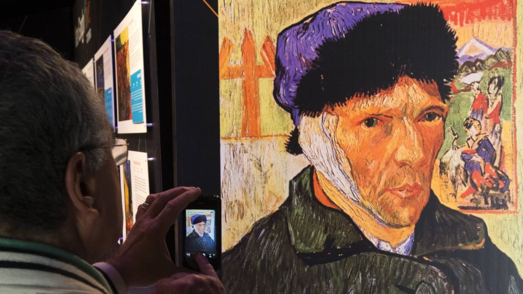 A Visitor Snaps Picture Of Self Portrait With Bandaged Ear By