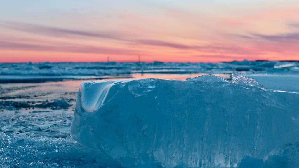 J. Ryan Macy took this photo of rare blue ice in the waters off Michigan's