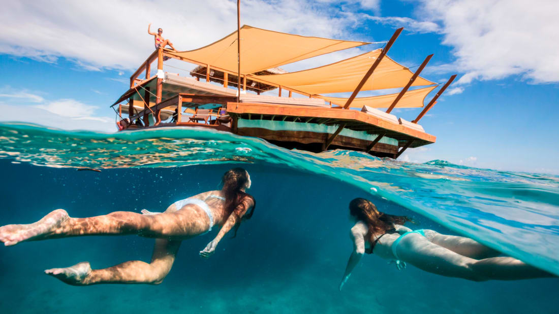 Cloud9 Fiji floating pizza restaurant - swimming