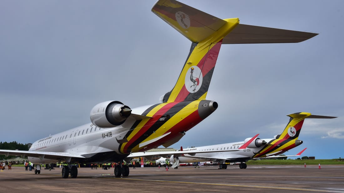 Newly acquired Uganda Airlines Bombardier CRJ900 aircraft stand on the runway at Entebbe Airport