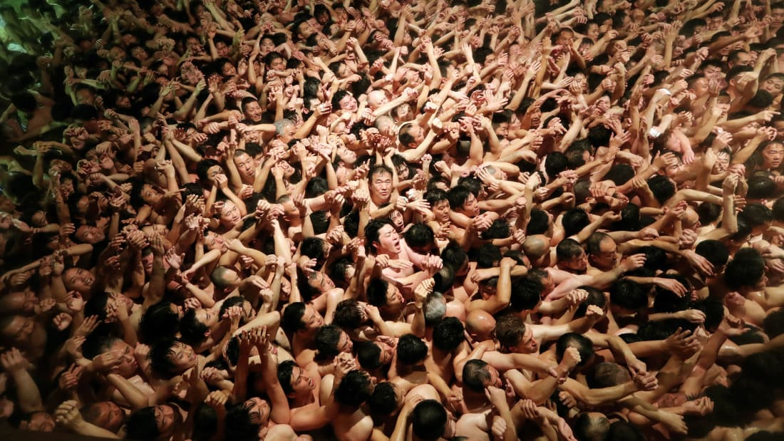 "Approximately 10,000 men in loincloths try to snatch a lucky wooden stick during the 'Eyo' naked festival at Saidaiji Temple on February 15, 2020 in Okayama, Japan. After all the lights were turned off, the chief priest tossed a pair of 20-centimetre-long ""shingi"" sacred sticks from a window 4 meters above ground into the massive throng. Those who left the temple grounds holding the shingi are considered ""lucky men"" of this year. The Saidaiji-eyo festival, said to date to the Muromachi Period (1338-1573). (Photo by The Asahi Shimbun via Getty Images )"