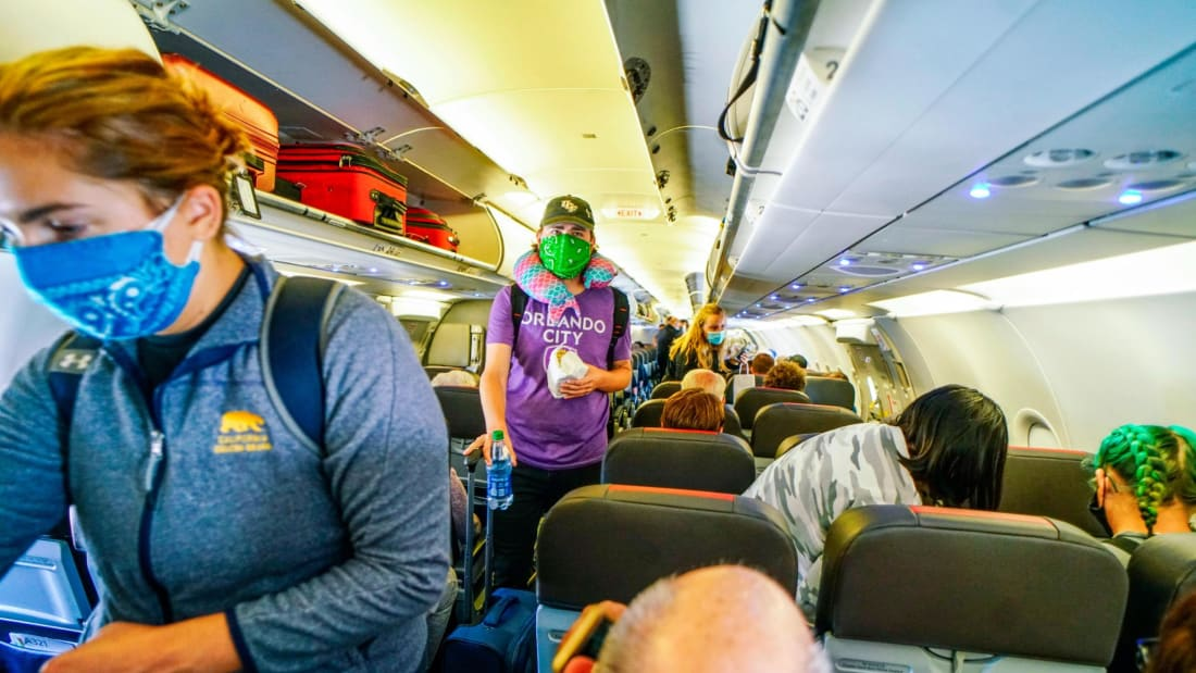 SAN DIEGO, CA-MAY 20:  Passengers board an American Airlines flight to Charlotte, North Carolina at San Diego International Airport on May 20, 2020 in San Diego, California. Air travel is down as estimated 94 percent due to the coronavirus (COVID-19) pandemic, causing U.S. airlines to take a major financial hit with losses of $350 million to $400 million a day as nearly half of major carriers' planes sit idle. (Photo by Sandy Huffaker/Getty Images)