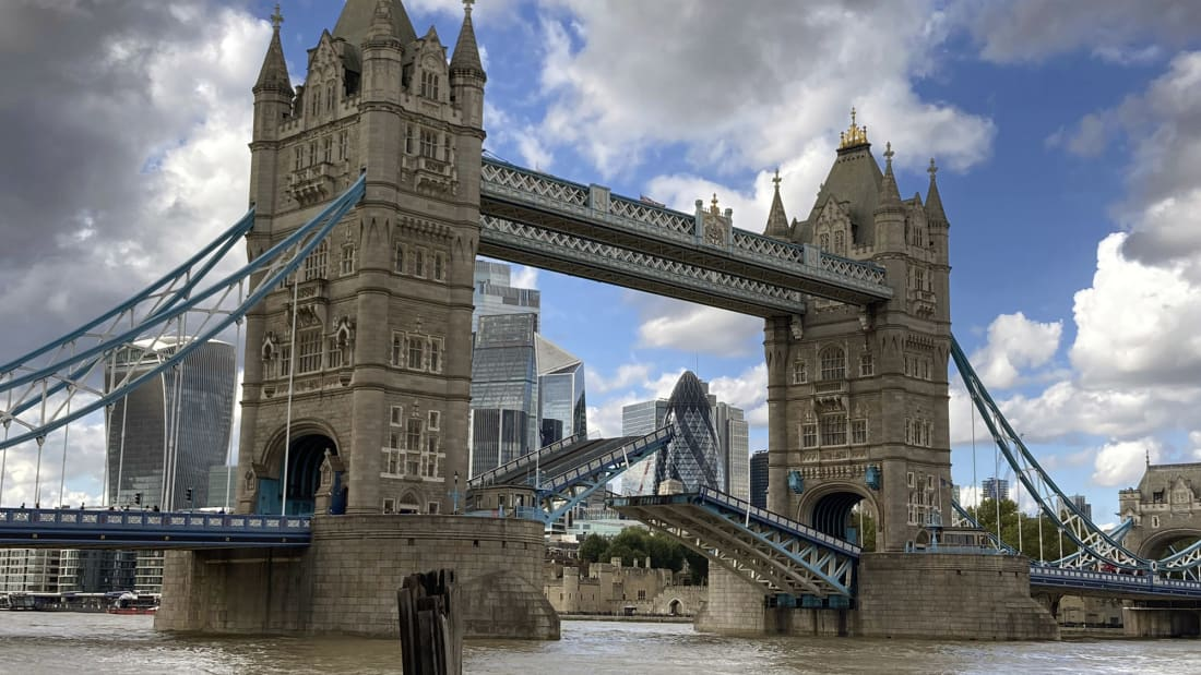 Tower Bridge crossing the River Thames is seen stuck open, leaving traffic in chaos and onlookers stunned.