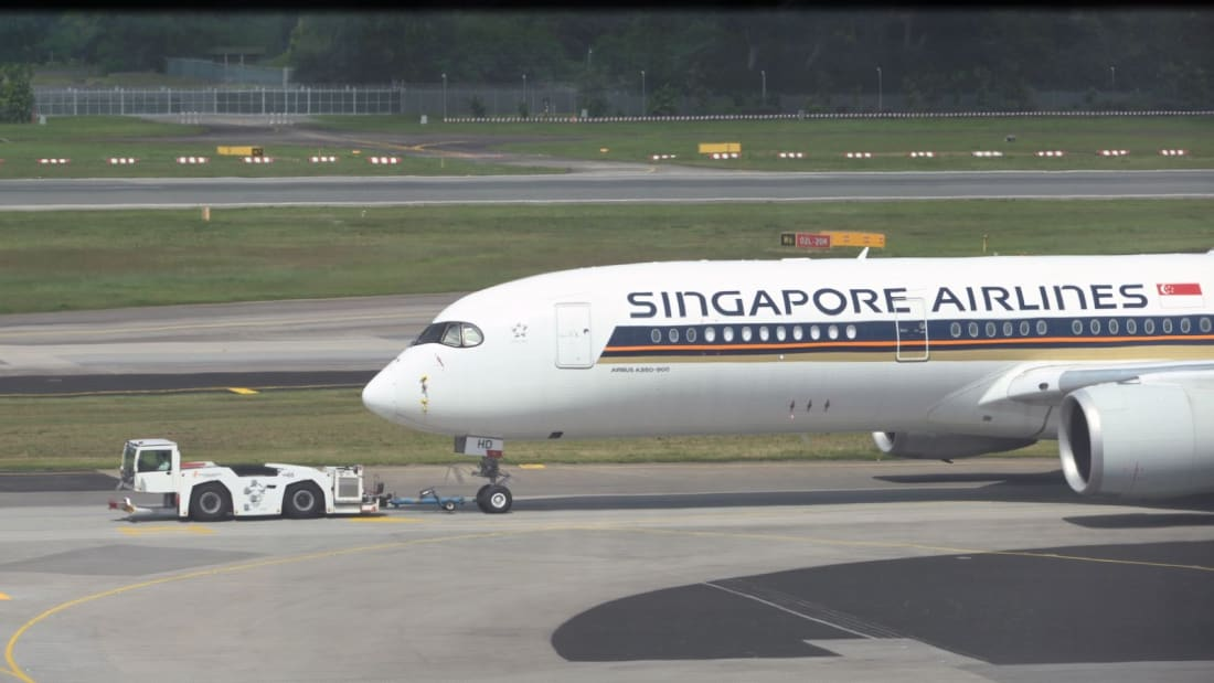 A Singapore Airlines passenger plane is towed to the terminal area of Changi International Airport on December 7, 2020.