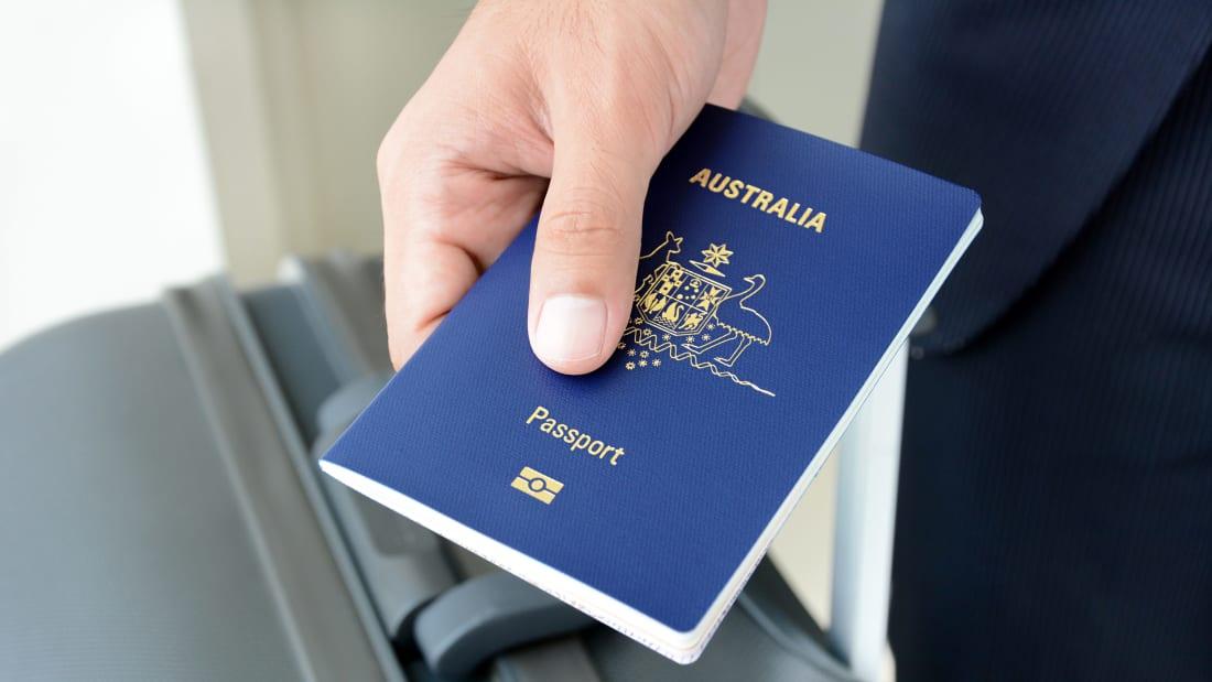 A traveler carries an Australian passport