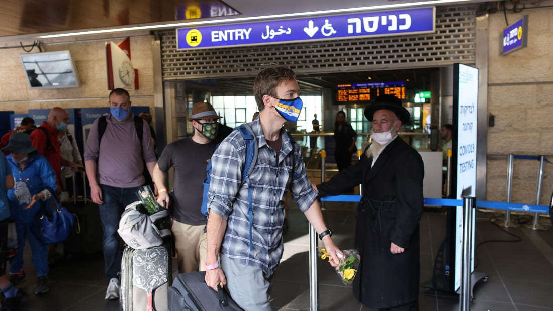 Tourists walk at the Ben Gurion International Airport after entering Israel by plane, as coronavirus disease (COVID-19) restrictions ease, in Lod, near Tel Aviv, Israel, May 27, 2021.